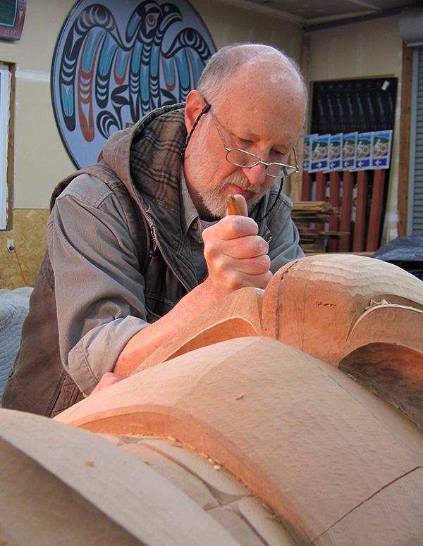 Dale Faulstich carving a totem pole.
