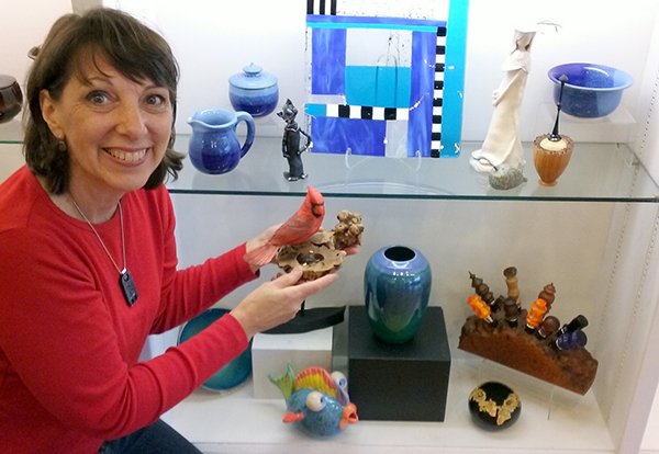 Karin Anderson preparing the Gift Gallery at Blue Whole Gallery