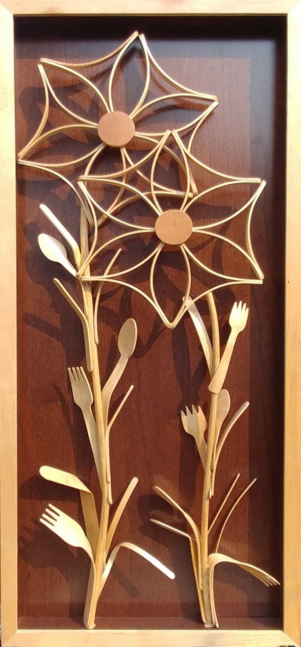 Benting wood flowers artwork by Brad Griffith at the Sequim Community Makerspace Inventing Studio