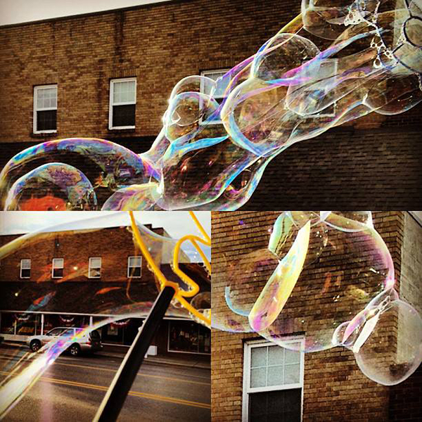 """bubbles in june"" by Renne Emiko Brock - with huge bubbles downtown Sequim"